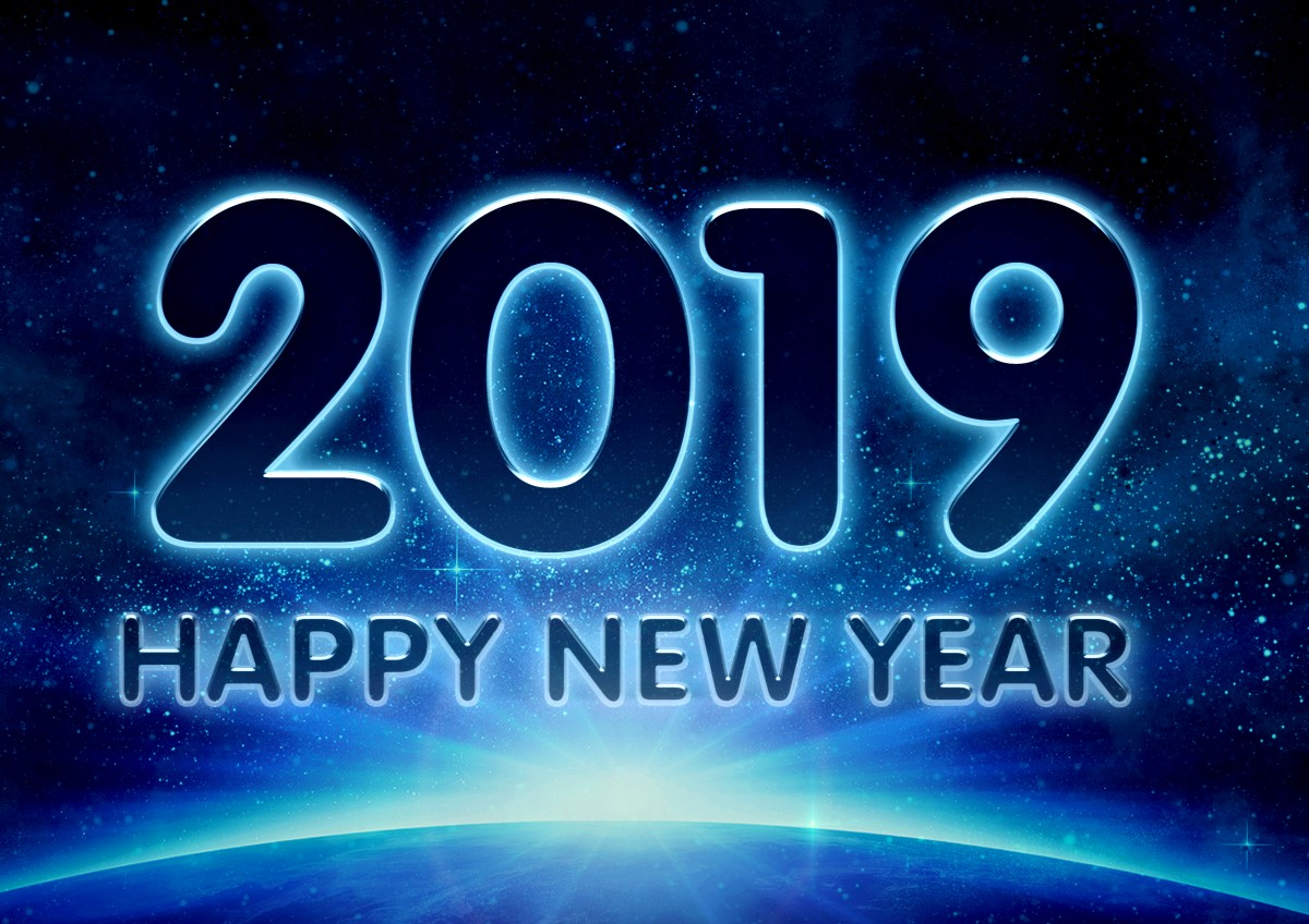 "Image of a new dawn in the world that reads ""2019 HAPPY NEW YEAR""."