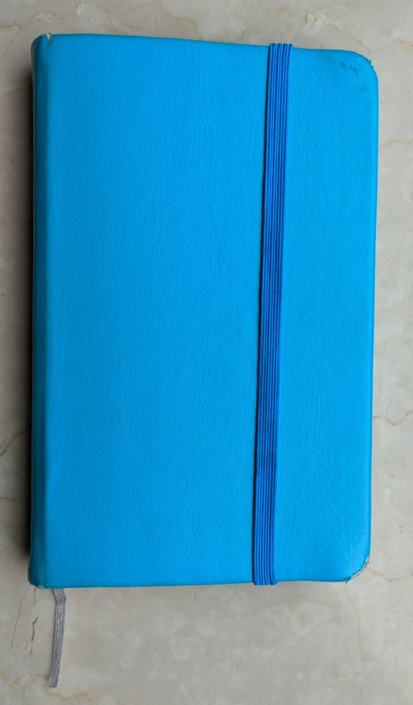 Blue notebook.