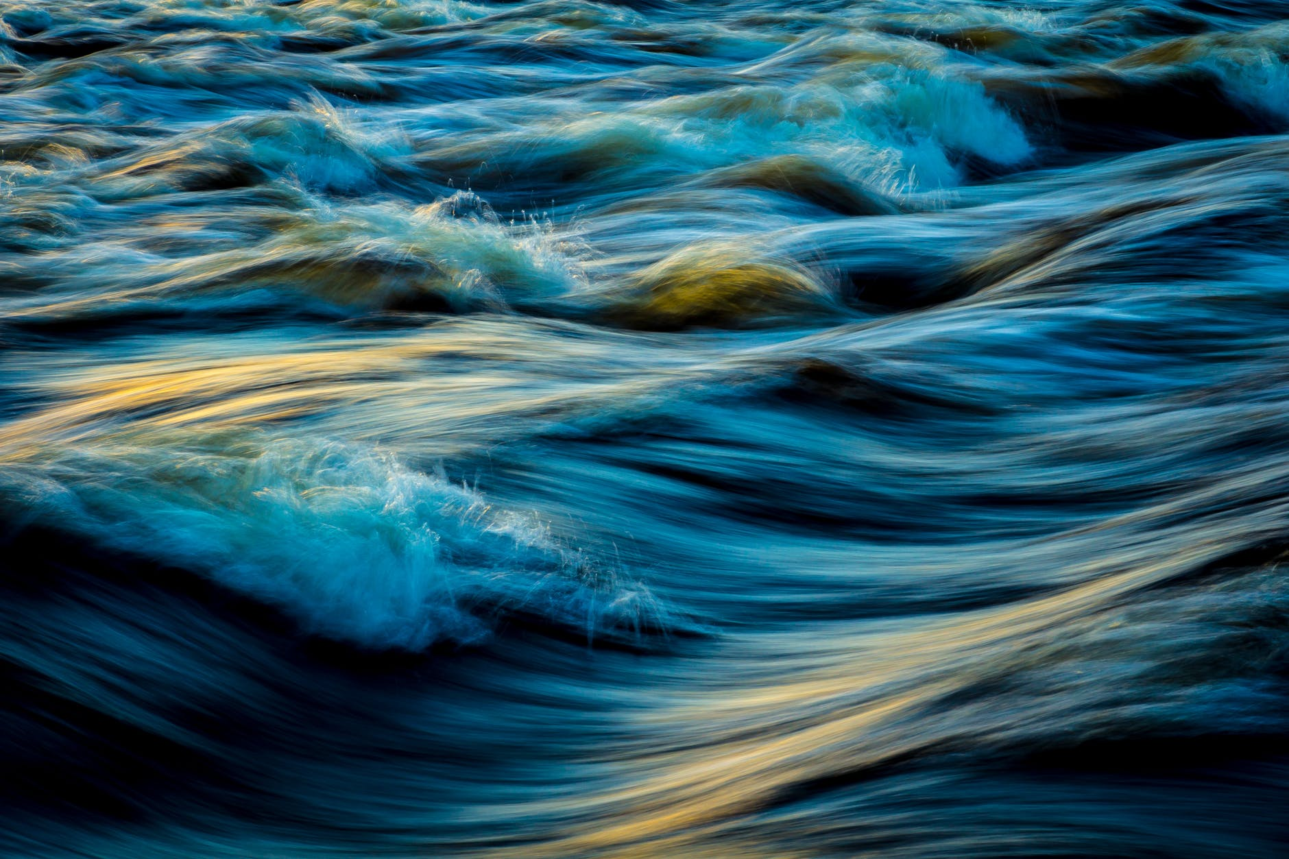 Light reflecting on wavy water.