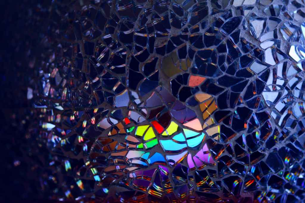 A mosaic with tiles of shattered glass that reflect rainbows.